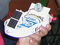 A kid shows proudly hist fist selfmade  Solarboat