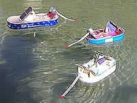 In newly cleaned fountain of Bad Reichenhall city hall Solarboats  are driving back and forth